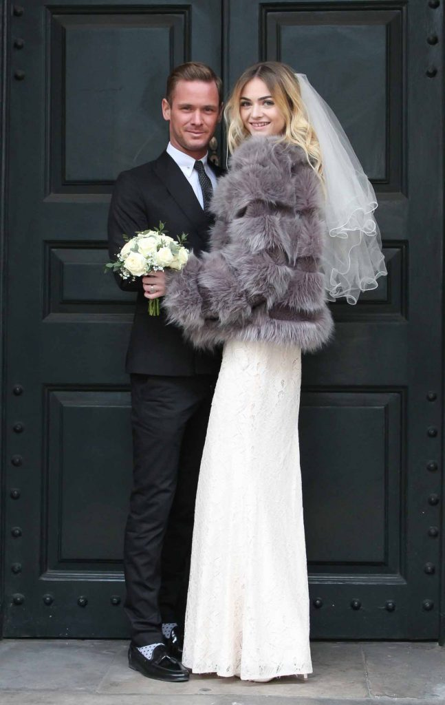 Winter bride and groom framed by beautiful black door by Kadi Berry Photography, Wedding photographer, Pembrokeshire West Wales