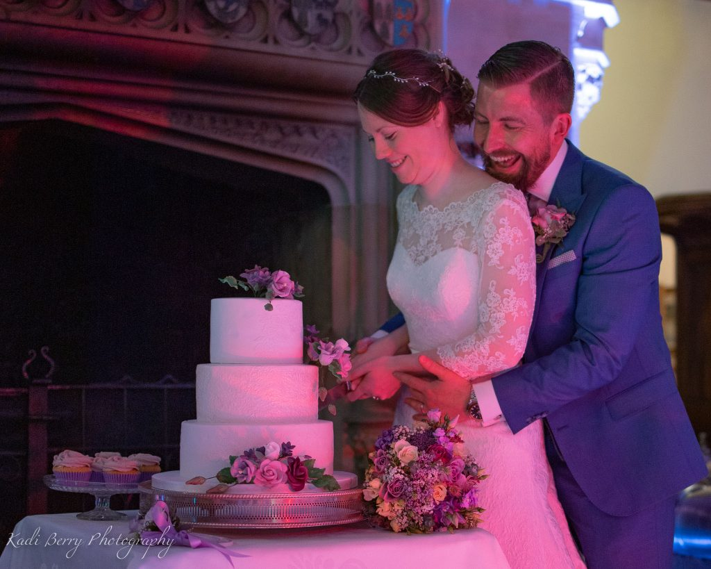 Cutting the cake in the Great Hall at St Audries Park, West Quantoxhead, Somerset… by Kadi Berry Photography, Pembrokeshire, Wales