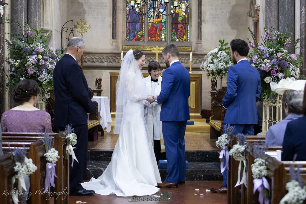The Bride and groom's vows at St Etheldreda's Church, St Audries Park, Somerset... by Kadi Berry Photography, Pembrokeshire, Wales