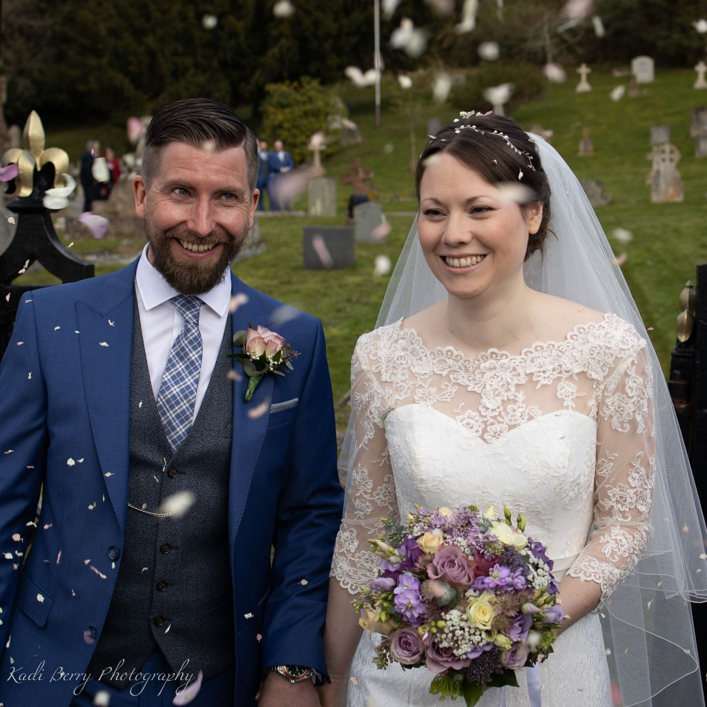 The Bride and groom's confetti moment at St Etheldreda's Church, St Audries Park, Somerset... by Kadi Berry Photography, Pembrokeshire, Wales