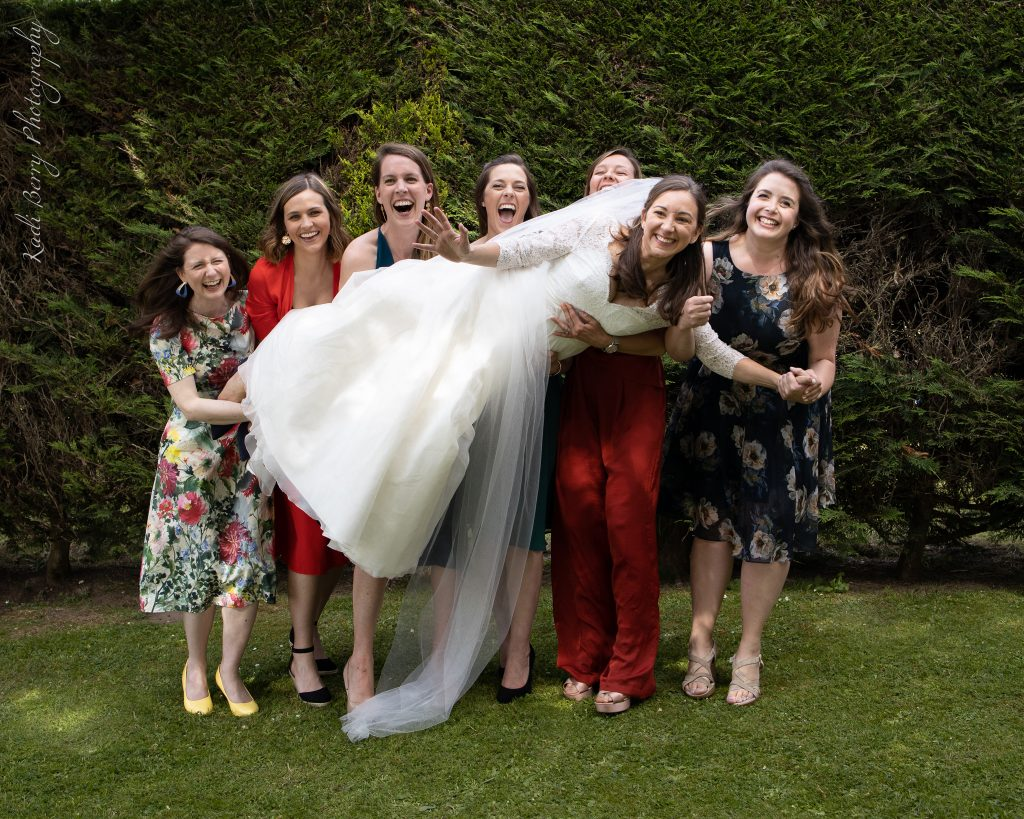 Horizontal Bride & crazy mates at Old Bridge, Somerset... by Kadi Berry Photography, Wales